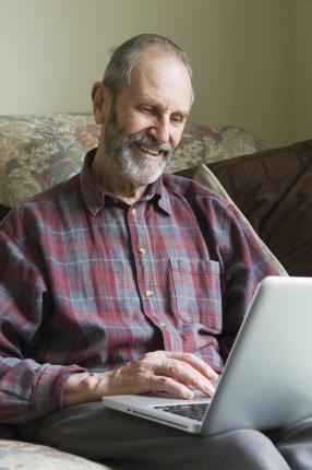man sitting with his laptop open