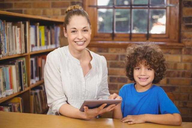 Teacher with student holding ipad