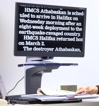 CCTV - Print Magnifier showing white enlarged text on a black screen