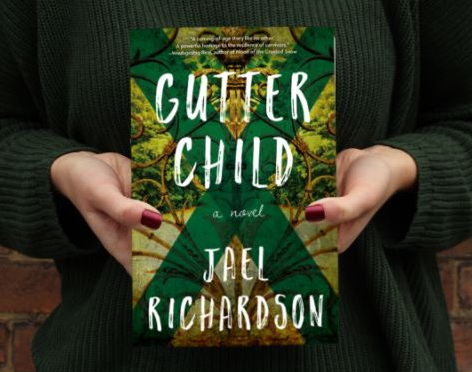 Person holding copy of Gutter child by Jael Richardson